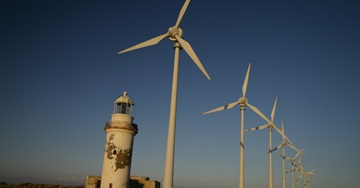 Wind turbines and a lighthouse